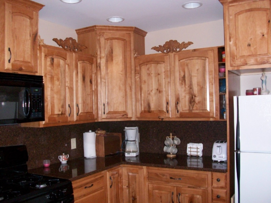Extravagant Kitchen with Knotty Maple and Silestone
